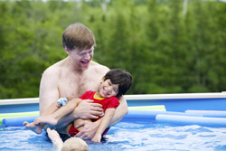 Dad and son in the swimming pool